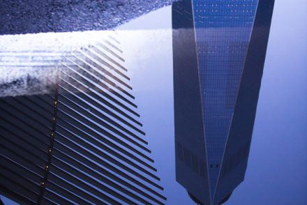 Reflection of World Trade Center in Puddle